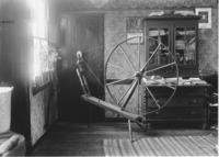 Interior with spinning wheel, Williamsville, Vt.