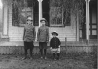 Three children in front of a house, Newfane, Vt.