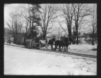 H. Brown and Mr. Bills' four horse team pulling sled, Williamsville, Vt.
