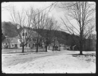 Unidentified house on Main St with H.A. Williams store in background, Williamsville, Vt.