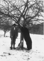 James Mundell standing next to a bear that he killed and a dog, Dover, Vt.