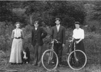 Two couples with bicycles and a dog