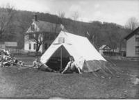 Young men in front of a tent in Vermont