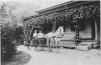 Mrs. Austin Powell in a carriage at the Brattleboro Retreat Farmhouse