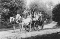 Claude Reed and his horse team, with a cart full of people, in Vermont