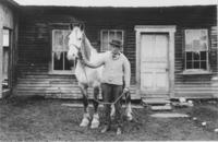 Hubert Brown with his horse, in front of his house, South Newfane, Vt.
