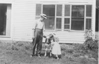 Marion Fairbanks and father with a calf, Williamsville, Vt.