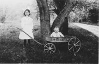 Florence Powers with a baby in a wagon, Williamsville, Vt.
