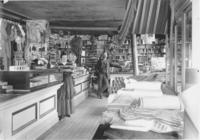 John A. Davis (and wife?) in his store in West Dover, Vt.