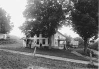 Farmhouse with people in front, either the Phillips, Cook or Pratt house