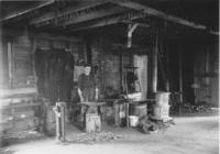 Interior of a blacksmith's shop in Jacksonville, Vt.