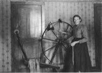Mrs. Laure Bingham with her spinning wheel, South Newfane, Vt.