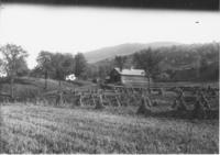 Field with corn harvest and barn, Townshend, Vt.