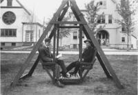 Frank Stevens and classmate on swing in front of Seminary, Townshend, Vt.