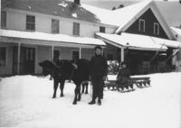 Frank and Grace Stratton with oxen and sled in snow, Williamsville, Vt.