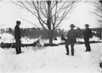 Men and dog on a coon hunt, Williamsville, Vt.