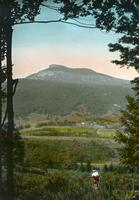 Couching Lion (Camel's Hump) - woman in the foreground