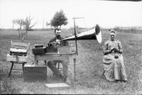 Couple with phonograph in a field
