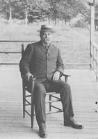 Admiral Clark on the porch of the Lake Mansfield Trout Club