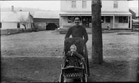 Woman with a child in a baby carriage