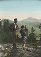 Man and boy on a rock clearing