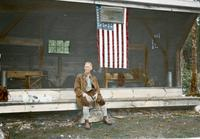 Man next to flag