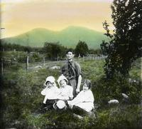 Reverend F.M. Hazen and children of Johnson, VT - Jay Peak in                              the background