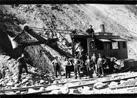 Railroad workers pictured with a steam powered shovel