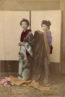Two women preparing their attire