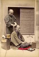An elderly man getting his hair styled