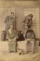 Two men getting their hair styled