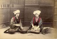 Two women preparing a meal