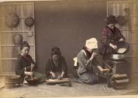 Four women preparing a meal