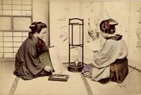 Two women practicing calligraphy