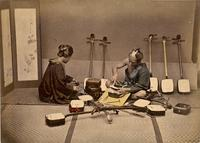 Shamisen crafter with a customer