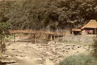 A bridge spanning a small river in the Japanese countryside