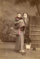 Woman carrying her child on her back