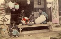A lantern maker and his family plying their trade