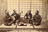 Group of men with Shamisen and sake