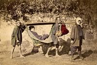Three men carrying a woman in a palanquin