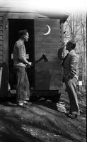 Bill Scott and Tom Sproston outside the research shed