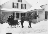 Delphia Yeaw and Wife on horse drawn sleigh in winter