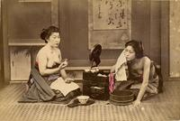 Two women bathing and dressing themselves
