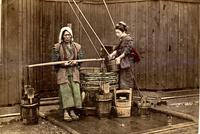 Two women getting water at a well