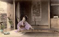 Woman practicing on a kokyu