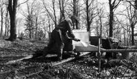 Worker pumping maple sap into pipeline